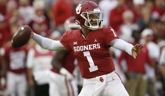 FILE - In this Sept. 22, 2018, file photo, Oklahoma quarterback Kyler Murray (1) throws in the first half of an NCAA college football game against Army, in Norman, Okla. Kyler Murray, the first-round Major League Baseball draft pick and Heisman Trophy-winning Oklahoma quarterback, says he is declaring himself eligible for the NFL draft. Murray announced his decision Monday, Jan. 14, 2019, in a tweet. (AP Photo/Sue Ogrocki) ** FILE **