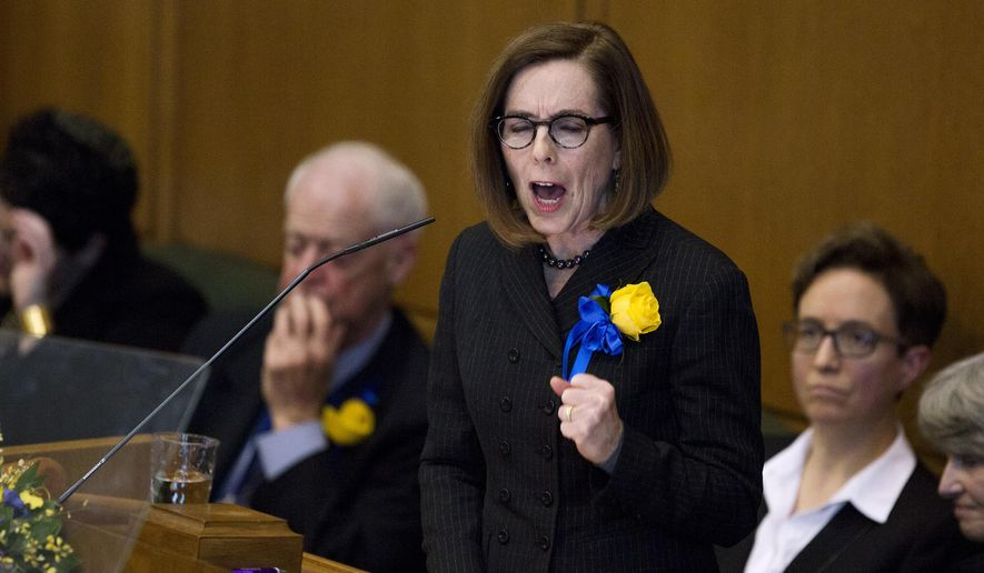 Gov. Kate Brown addresses the state legislature at her inauguration at her inauguration at the Oregon state Capitol in Salem, Ore., Monday, Jan. 14, 2019. Oregon needs to shore up health care, the environment, the education system and housing, Gov. Kate Brown said during her State of the State address Monday. (Michaela Roman/Statesman-Journal via AP)