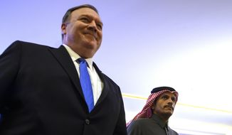 U.S. Secretary of State Mike Pompeo, left, and Qatari Foreign Minister Sheikh Mohammed bin Abdulrahman Al Thani, arrive at the Sheraton Grand in Doha, Qatar to hold a joint press conference, Sunday, Jan. 13, 2019. (Andrew Caballero-Reynolds/Pool Photo via AP)