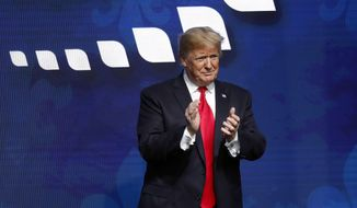 President Donald Trump acknowledges the crowd after speaking at the American Farm Bureau Federation convention in New Orleans, Monday, Jan. 14, 2019. (AP Photo/Gerald Herbert)