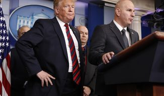 FILE - In this Jan. 3, 2019, file photo, President Donald Trump, left, listens as Brandon Judd, president of the National Border Patrol Council, talks about border security after making a surprise visit to the press briefing room of the White House in Washington. Trump and Judd share an ominous view of the southern border and a certainty that a wall along the boundary is urgently needed to stop what they've described as a humanitarian crisis. Judd, a 21-year veteran of the U.S. Border Patrol, has helped to validate Trump's fiery immigration rhetoric and affirm the president's conviction the border with Mexico is a frequently lawless place. (AP Photo/Jacquelyn Martin, File)