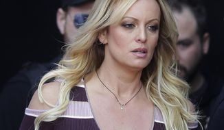 """FILE - In this Oct. 11, 2018, file photo, adult film actress Stormy Daniels arrives for the opening of the adult entertainment fair """"Venus"""" in Berlin.  Daniels has sued the Columbus police department for $2 million over her arrest at a strip club last summer. The federal defamation lawsuit filed Monday, Jan. 14, 2019, alleges officers conspired to retaliate against Daniels for her sex allegations concerning Donald Trump before he became president. (AP Photo/Markus Schreiber, File)"""