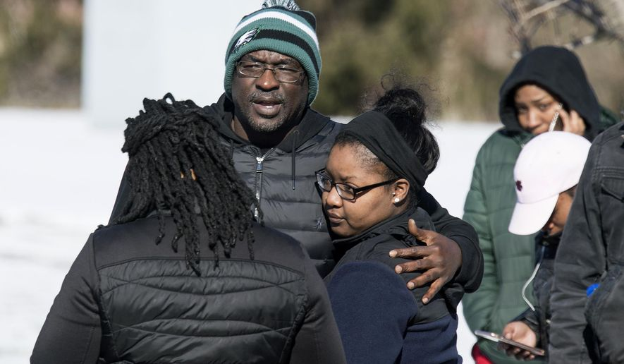 People watch as officials respond to reports of an active shooter at a UPS facility Monday, Jan. 14, 2019 in Logan Township, N.J. (Joe Lamberti/Camden Courier-Post via AP)