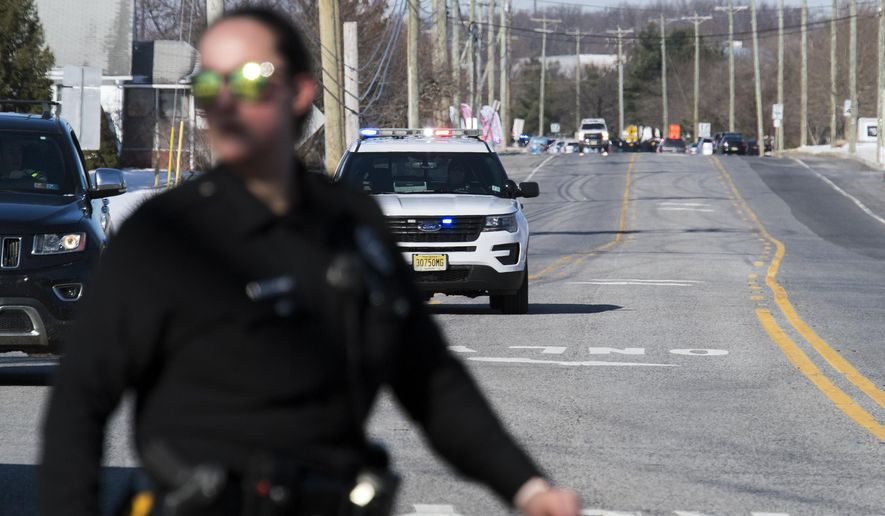 Officials respond to reports of an active shooter at a UPS facility Monday, Jan. 14, 2019 in Logan Township, N.J. (Joe Lamberti/Camden Courier-Post via AP)