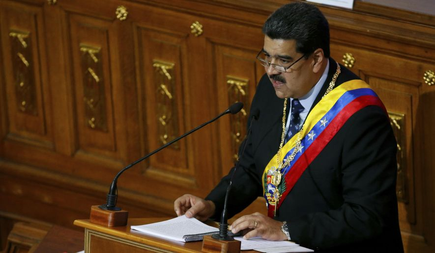 Venezuela's President Nicolas Maduro gives his annual address to the nation, before members of the Constitutional Assembly inside the National Assembly in Caracas, Venezuela, Monday, Jan. 14, 2019. Venezuela's economic crisis is deepening, with masses fleeing the country to escape runaway inflation on pace to surpass 23 million percent. (AP Photo/Ariana Cubillos)