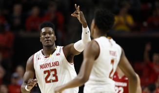 Maryland forward Bruno Fernando, of Angola, (23) gestures to teammate Aaron Wiggins after Wiggins made a 3-pointer in the first half of an NCAA college basketball game against Wisconsin, Monday, Jan. 14, 2019, in College Park, Md. (AP Photo/Patrick Semansky)