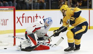 Nashville Predators left wing Viktor Arvidsson (33), of Sweden, scores his third goal of the night, against Washington Capitals goaltender Pheonix Copley (1), during the second period of an NHL hockey game Tuesday, Jan. 15, 2019, in Nashville, Tenn. (AP Photo/Mark Humphrey)