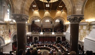 Members of the New York Senate debate protecting LGBTQ rights in the Senate Chamber at the state Capitol in Albany, N.Y. on Tuesday, Jan. 15, 2019. Lawmakers in New York state have voted to ban gay conversion therapy and add gender identity and expression to the state's anti-discrimination laws. (AP Photo/Hans Pennink)