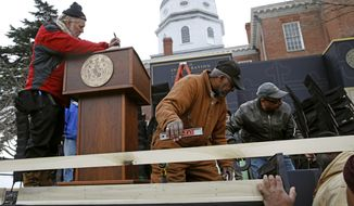 Workers prepare a stage for Maryland Gov. Larry Hogan's inauguration ceremony, Tuesday, Jan. 15, 2019, outside the Maryland State House in Annapolis, Md. Hogan, who was re-elected in November, is scheduled to be sworn in Wednesday. (AP Photo/Patrick Semansky)
