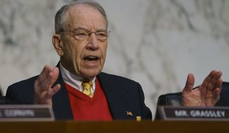 Senate Judiciary Committee committee member Sen. Chuck Grassley, R-Iowa, questions Attorney General nominee William Barr during a Senate Judiciary Committee on Capitol Hill in Washington, Tuesday, Jan. 15, 2019. (AP Photo/Carolyn Kaster) **FILE**