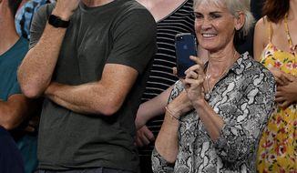 Jamie and Judy Murray watch a presentation for Britain's Andy Murray following his first round loss to Spain's Roberto Bautista Agut at the Australian Open tennis championships in Melbourne, Australia, Monday, Jan. 14, 2019. (AP Photo/Andy Brownbill)