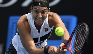 France's Caroline Garcia makes a backhand return to Australia's Zoe Hives during their second round match at the Australian Open tennis championships in Melbourne, Australia, Wednesday, Jan. 16, 2019. (AP Photo/Andy Brownbill)