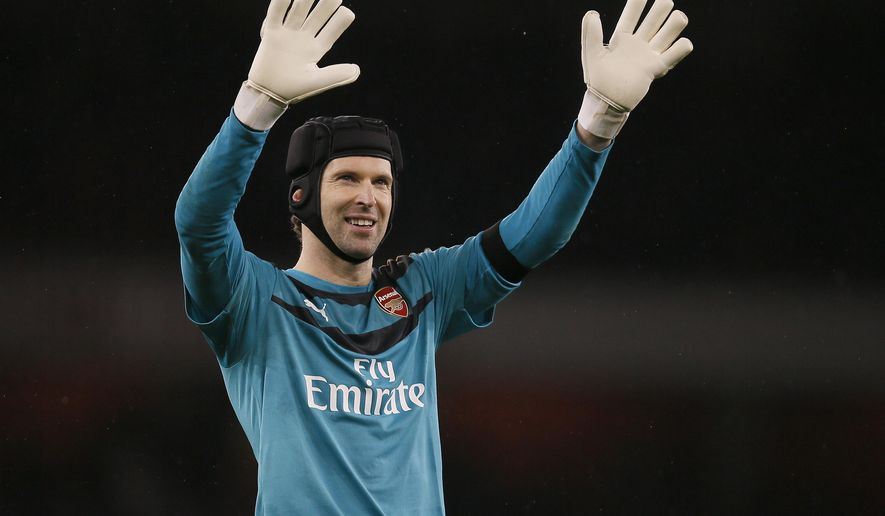 FILE -- In this Saturday, Jan. 2, 2016 photo Arsenal's Petr Cech waves to fans after the English Premier League soccer match between Arsenal and Newcastle United at Emirates stadium in London. Petr Cech says he is planning to retire from soccer at the end of the season. (AP Photo/Kirsty Wigglesworth, file)