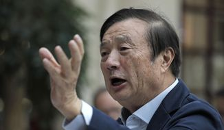 Ren Zhengfei, founder and CEO of Huawei, gestures during a round table meeting with the media in Shenzhen city, south China's Guangdong province, Tuesday, Jan. 15, 2019. Ren, trying to allay security fears, says company would deny government requests for customer information. (AP Photo/Vincent Yu)