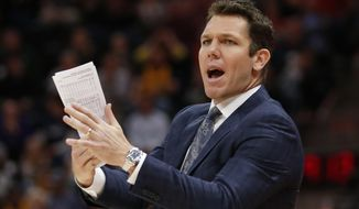 FILE - In this April 3, 2018 file photo, Los Angeles Lakers head coach Luke Walton shouts to his team in the second half during an NBA basketball game against the Utah Jazz in Salt Lake City. Luke Walton began a wellness program for his Lakers coaching staff. Steve Kerr called Steve Clifford in support after each spent significant time away from the sideline because of debilitating headaches among other symptoms. The NBA Coaches Association now provides guidance to its members on everything from diet and exercise to sleep and mental health. (AP Photo/Rick Bowmer, File)