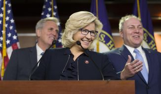 House Minority Leader Kevin McCarthy of Calif., left, House Republican Conference chair Rep. Liz Cheney, R-Wyo., and House Minority Whip Steve Scalise of La., smile as they arrive for a news conference on Capitol Hill, Tuesday, Jan. 15, 2019 in Washington. (AP Photo/Alex Brandon)