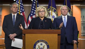 House Republican Conference chair Rep. Liz Cheney, R-Wyo., center, accompanied by House Minority Leader Kevin McCarthy of Calif., left, and House Minority Whip Steve Scalise of La., speaks at a news conference on Capitol Hill, Tuesday, Jan. 15, 2019 in Washington. (AP Photo/Alex Brandon) ** FILE **