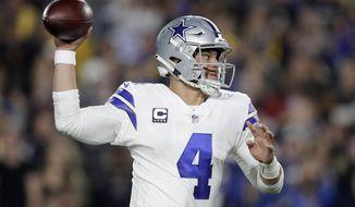 Dallas Cowboys quarterback Dak Prescott passes against the Los Angeles Rams during the first half in an NFL divisional football playoff game Saturday, Jan. 12, 2019, in Los Angeles. (AP Photo/Jae C. Hong)