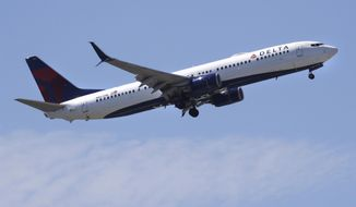 FILE- In this May 24, 2018, file photo a Delta Air Lines passenger jet plane, a Boeing 737-900 model, approaches Logan Airport in Boston. Delta Air Lines, Inc. reports financial results Tuesday, Jan. 15, 2019. (AP Photo/Charles Krupa, File)
