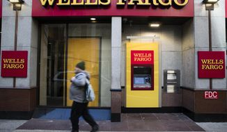This Thursday, Nov. 29, 2018, photo shows a Wells Fargo bank location in Philadelphia. Wells Fargo & Co. reports financial results Tuesday, Jan. 15, 2019. (AP Photo/Matt Rourke, File)