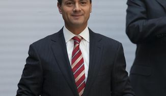 "FILE- In this Feb. 25, 2013 file photo, Enrique Pena Nieto, the president of Mexico, is seen at the National Palace in Mexico City. On Tuesday, Jan. 15, 2019, Alex Cifuentes, a Colombian drug trafficker, testified in a New York courtroom that Mexican cartel leader Joaquin ""El Chapo"" Guzman boasted about paying a $100 million bribe to the former president of Mexico.  Cifuentes was testifying at Guzman's drug trafficking trial. (AP Photo/Alexandre Meneghini, File)"