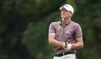 FILE - In this July 15, 2018, file photo, Steve Stricker hits on the ninth fairway during the final round of the John Deere Classic golf tournament, in Silvis, Ill.  Stricker, who is about to turn 52, is not ready for a fulltime schedule on the PGA Tour Champions.(AP Photo/Charlie Neibergall, File)