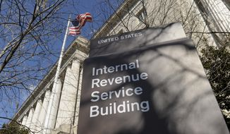 This March 22, 2013, file photo, shows the exterior of the Internal Revenue Service building in Washington. The Internal Revenue Service is recalling about 46,000 of its employees furloughed by the government shutdown, nearly 60 percent of its workforce, to handle tax returns and pay out refunds. The employees won't be paid. (AP Photo/Susan Walsh, File)