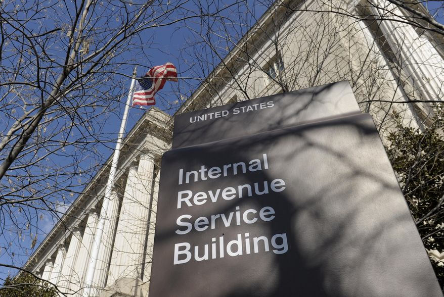 This March 22, 2013, file photo, shows the exterior of the Internal Revenue Service building in Washington.  (AP Photo/Susan Walsh, File)
