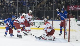 New York Rangers right wing Pavel Buchnevich, left, scores a goal past Carolina Hurricanes goaltender Curtis McElhinney (35) during the second period of an NHL hockey game Tuesday, Jan. 15, 2019, at Madison Square Garden in New York. (AP Photo/Mary Altaffer)