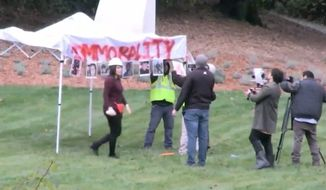 "Conservative provocateur Laura Loomer's latest stunt included bringing a trio of self-described illegal immigrants to set up a ""sanctuary"" on House Speaker Nancy's Pelosi's lawn in California. (Periscope/@Unite America First)"