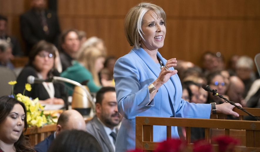 New Mexico Gov. Michelle Lujan Grisham gives her State of the State address during the opening of the New Mexico legislative session at the state Capitol in Santa Fe, N.M. on Tuesday, Jan. 15, 2019. (AP Photo/Craig Fritz)