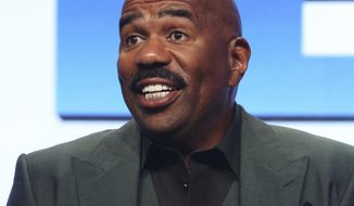 """FILE - In this Aug. 3, 2017, file photo, host/executive producer Steve Harvey participates in the """"Steve"""" panel during the NBC Television Critics Association Summer Press Tour in Beverly Hills, Calif. Steve Harvey will host the NFL Honors show on Feb. 2, 2019, when The Associated Press hands out its individual league awards. The two-hour prime-time show airing on CBS will be held at the Fox Theatre in Atlanta. (Photo by Willy Sanjuan/Invision/AP, File)"""