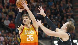 Detroit Pistons guard Luke Kennard, right, defends against Utah Jazz guard Kyle Korver (26) during the second half of an NBA basketball game Monday,Jan. 14 , 2019, in Salt Lake City. (AP Photo/Rick Bowmer)