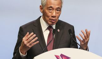FILE - In this Nov. 15, 2018, file photo, Singaporean Prime Minister Lee Hsien Loong speaks during a press conference following the 33rd ASEAN summit in Singapore. Singapore officials say it isn't in the country's interest to nab - or even name - the perpetrators behind a cyberattack that breached 1.5 million health records, including those of Prime Minister Lee. An inquiry into the July 4 breach, believed to be the largest in Singapore's history, concluded that it was likely state-linked. Lee, a two-time cancer survivor, had his personal and outpatient medication data repeatedly targeted. (AP Photo/Yong Teck Lim, File)