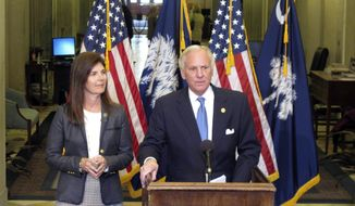 South Carolina Gov. Henry McMaster, right, talks about his budget proposal alongside Lt. Gov. Pamela Evette, left, at the Statehouse in Columbia, S.C., on Tuesday, Jan. 15, 2019. McMaster's spending plan would give teachers a 5 percent pay raise and taxpayers a rebate totaling $200 million.(AP Photo/Jeffrey Collins)