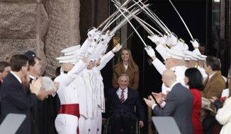 Texas Gov. Greg Abbott, front center, arrives for his inauguration ceremony with his daughter, Audrey, in Austin, Texas, Tuesday, Jan. 15, 2019. (AP Photo/Eric Gay)