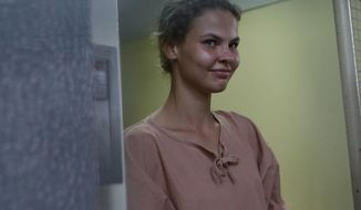 FILE - In this Monday, Aug. 20, 2018, file photo, Anastasia Vashukevich, leaves the Pattaya Provincial Court in Chonburi province, Thailand. A model from Belarus who claimed last year that she had evidence of Russian involvement in helping elect Donald Trump president has pleaded guilty in a Thai court in a case related to holding a sex training seminar and will be deported. A lawyer representing Anastasia Vashukevich said she and seven co-defendants would be freed Tuesday night Jan. 15, 2019, and deported. (AP Photo/Sakchai Lalit, File)