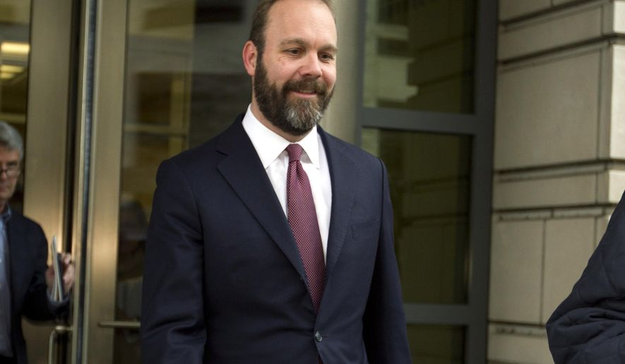 In this Feb. 23, 2018, photo, Rick Gates leaves federal court in Washington. (AP Photo/Jose Luis Magana) **FILE**