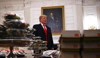 President Trump treated the Clemson football team to a fast food feast on Monday at the White House, one which caused his critics to cringe. (Associated Press)