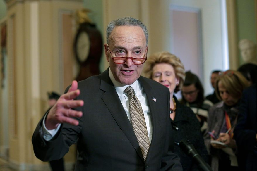 Senate Minority Leader Chuck Schumer, D-N.Y., speaks to reporters following a weekly policy meeting on Capitol Hill in Washington, Tuesday, Jan. 15, 2019. (AP Photo/J. Scott Applewhite) **FILE**