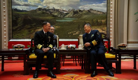 Adm. John Richardson (left), chief of naval operations, met this week with senior officials of China's People's Liberation Army to continue dialogue and to specifically address risk reduction and operational safety measures during encounters at sea. (U.S. Navy)