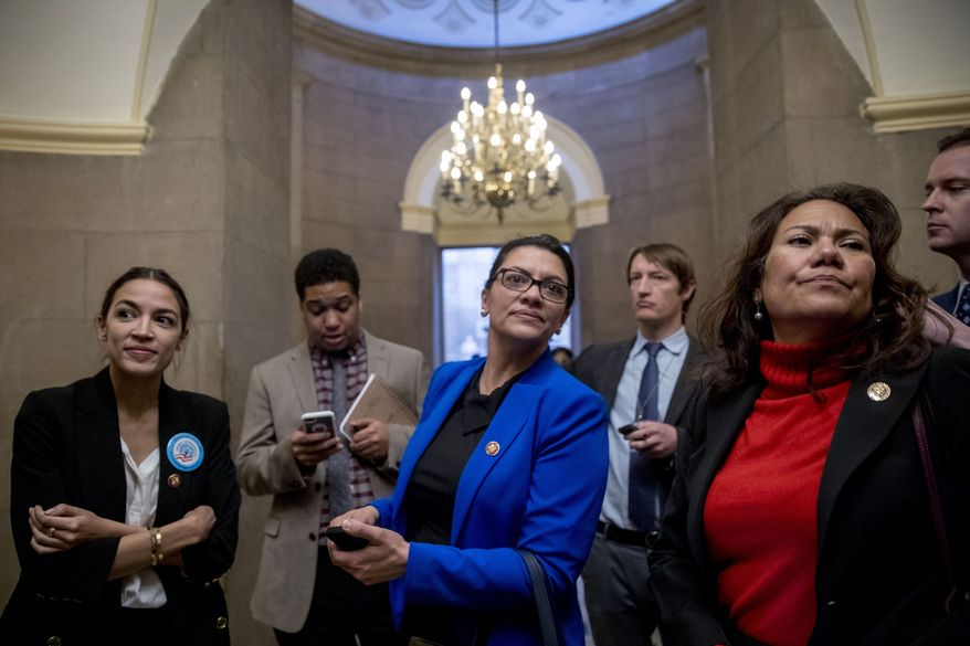 Rep. Alexandria Ocasio-Cortez, D-N.Y., left, Rep. Rashida Tlaib, D-Mich., second from left, and Rep. Veronica Escobar, D-Texas, second from right, wait for other freshman Congressmen to deliver a letter calling to an end to the government shutdown to deliver to the office of Senate Majority Leader Mitch McConnell of Ky., on Capitol Hill in Washington, Wednesday, Jan. 16, 2019. (AP Photo/Andrew Harnik)