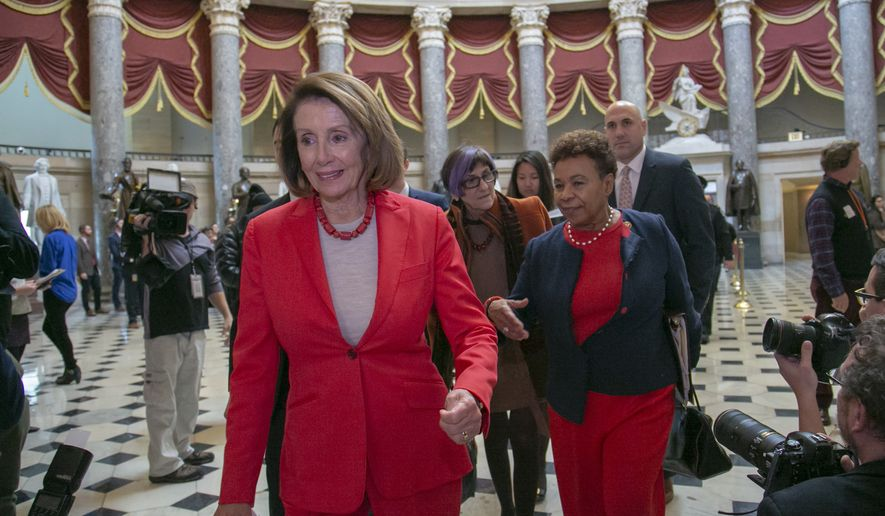 Speaker of the House Nancy Pelosi, D-Calif., followed by Rep. Rosa DeLauro, D-Conn., center, and Rep. Barbara Lee, D-Calif., as they walk to the House chamber on Capitol Hill in Washington, Wednesday, Jan. 16, 2019. (AP Photo/J. Scott Applewhite)