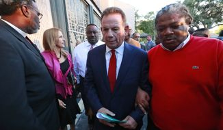Suspended Broward County Sheriff Scott Israel, center, leaves a news conference surrounded by supporters after new Florida Gov. Ron DeSantis suspended him, Friday, Jan. 11, 2019, in Fort Lauderdale, Fla., over his handling of February's massacre at Marjory Stoneman Douglas High School. (AP Photo/Wilfredo Lee)