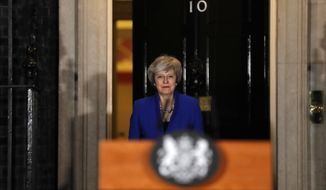 British Prime Minister Theresa May arrives to speak outside 10 Downing street in London, Wednesday, Jan. 16, 2019. May's government survived a no-confidence vote Wednesday called after May's Brexit deal was overwhelmingly rejected by lawmakers. (AP Photo/Frank Augstein)