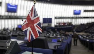 "A British flag is pictured at the European Parliament during a debate on Brexit, Wednesday, Jan.16, 2019 in Strasbourg. European Union Brexit negotiator Michel Barnier says the bloc is stepping up preparations for a chaotic no-deal departure of Britain from the bloc after the rejection of the draft withdrawal deal in London left the EU ""fearing more than ever that there is a risk"" of a cliff-edge departure. (AP Photo/Jean-Francois Badias)"