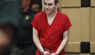 Parkland school shooting suspect Nikolas Cruz enters the courtroom for a hearing at the Broward Courthouse in Fort Lauderdale, Fla., Tuesday, Jan. 15, 2019. Cruz returned court this week for hearings on the Valentine's Day 2018 shooting at Marjory Stoneman Douglas High School in Parkland, Fla., and on accusations he assaulted a corrections officer. (Amy Beth Bennett/South Florida Sun-Sentinel via AP, Pool)