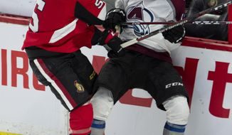 Ottawa Senators defenseman Cody Ceci collides with Colorado Avalanche center Tyson Jost along the boards during the third period of an NHL hockey game, Wednesday, Jan. 16, 2019 in Ottawa, Ontario. (Adrian Wyld/The Canadian Press via AP)