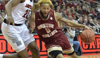 Boston College guard Ky Bowman (0) attempts to drive past Louisville center Steven Enoch (23) during the first half of an NCAA college basketball game in Louisville, Ky., Wednesday, Jan. 16, 2019. (AP Photo/Timothy D. Easley)