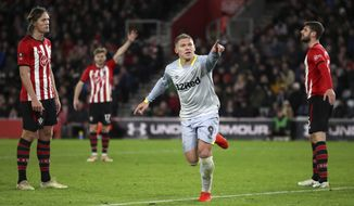 Derby County's Martyn Waghorn celebrates scoring his side's second goal of the game against Southampton, during their English FA Cup third round replay soccer match at St Mary's Stadium in Southampton, England, Wednesday Jan. 16, 2019. (Nick Potts/PA via AP)